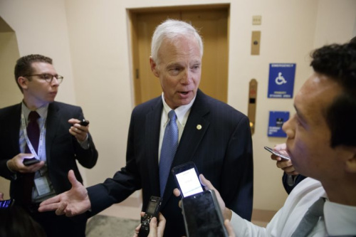 Sen. Ron Johnson, R-Wis. responds to reporters as he and other Senators arrive for weekly policy meetings on Capitol Hill in Washington, Tuesday, July 11, 2017. (Photo: J. Scott Applewhite/AP)