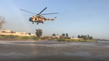 Helicopter Flies in to Rescue People in Tigris River Following Fatal Ferry Disaster