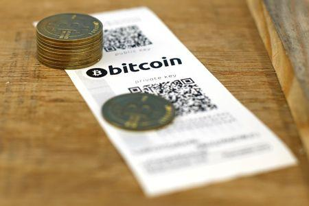A Bitcoin (virtual currency) paper wallet with QR codes and coins are seen in an illustration picture taken at La Maison du Bitcoin in Paris