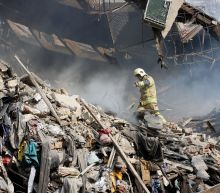 Desperate search for trapped Iran firefighters