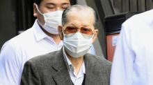 Japan police arrest fraud suspect linked to ex-PM's event