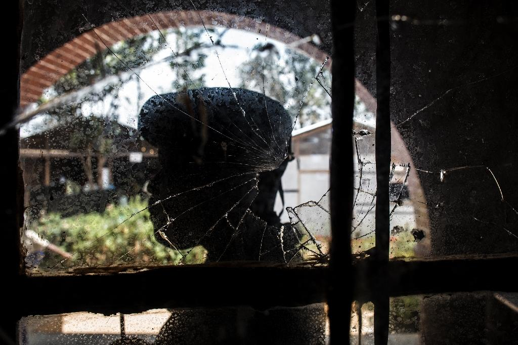 A bullet-shattered window at an Ebola treatment centre in Butembo after it came under attack on March 9. A policeman was killed and a health worker wounded (AFP Photo/JOHN WESSELS)