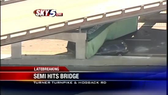 SUV trapped under flipped Semitrailer on Turner Turnpike