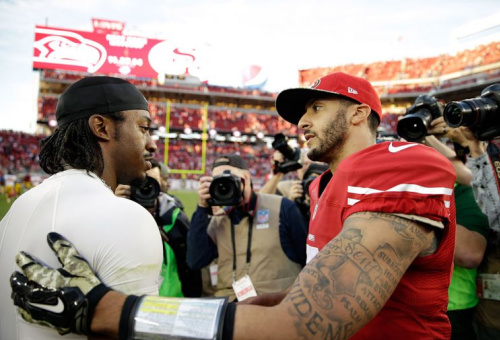 Robert Griffin III, Colin Kaepernick in happier, more employed days. (Getty Images)