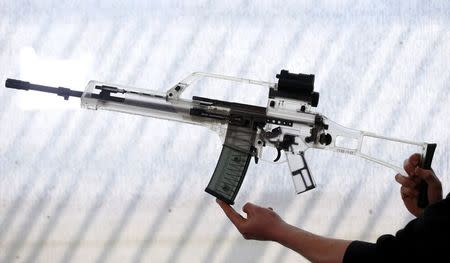 A transparent plastic demonstration model of a G 36 assault rifle manufactured by Heckler & Koch is seen during a guided media tour at arms factory Heckler & Koch in Oberndorf, 80 kilometers southwest of Stuttgart, Germany, May 8, 2015. REUTERS/Ralph Orlowski