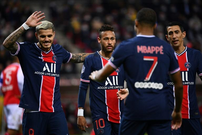 Mauro Icardi (L) celebrates with the other members of Paris Saint-Germain's 'Fantastic Four', Neymar Kylian Mbappe and Angel di Maria, after scoring the opening goal in Rheims