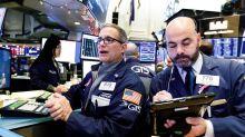El verde se asoma con timidez a un volátil Wall Street