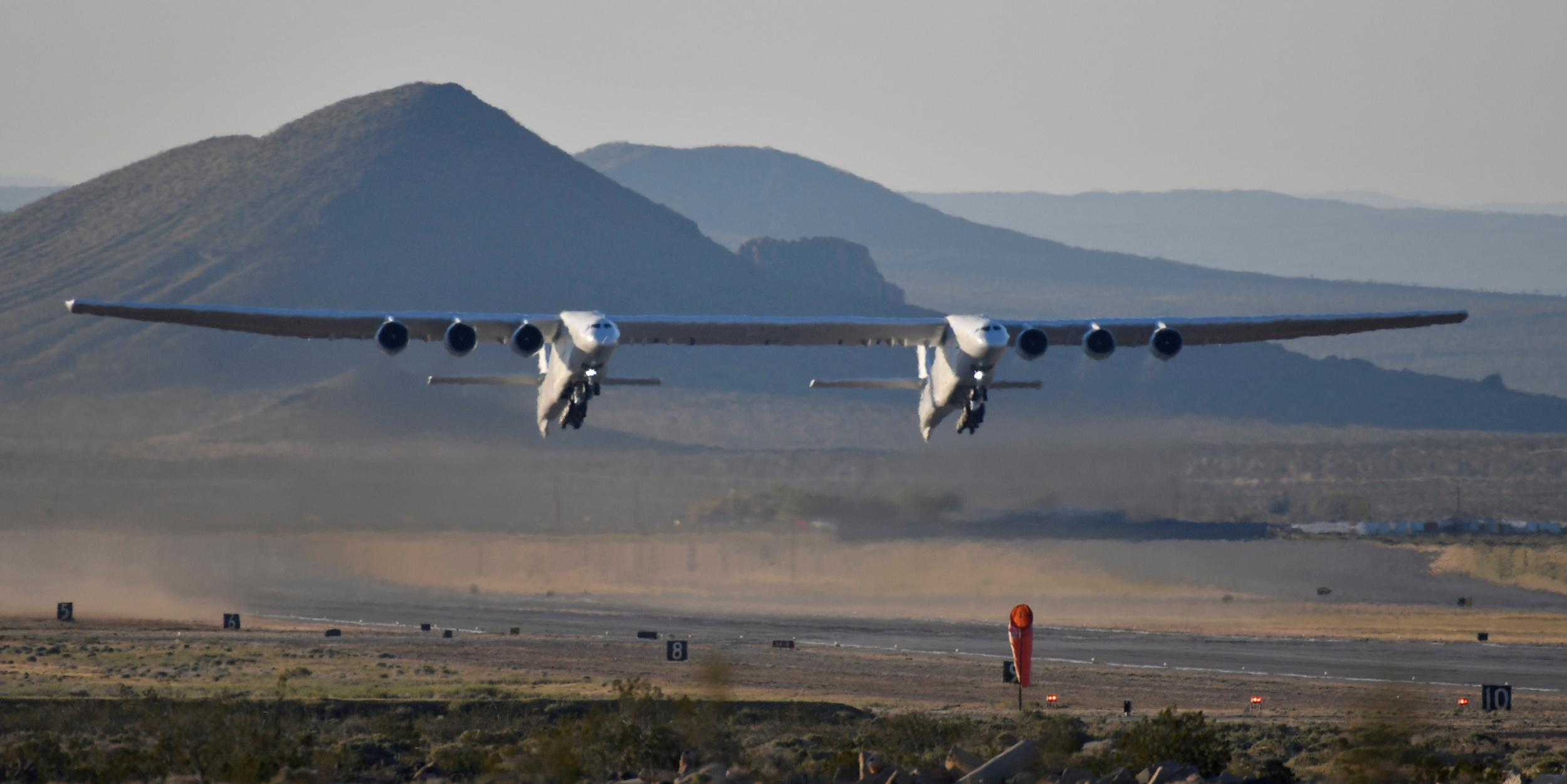 The world's largest airplane, built by the late Paul Allen's company Stratolaunch Systems, takes off on its first test flight in Mojave, California, U.S. April 13, 2019.  REUTERS/Gene Blevins