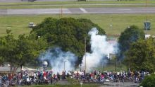 Venezuelan troops fire on protesters at airbase, one killed