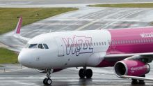 Wizz Air plane lands in London in tentative return to commercial flights