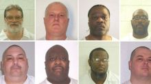 Arkansas court halts two executions, U.S. court OKs others