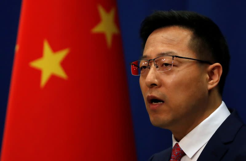 Chinese Foreign Ministry spokesman Zhao Lijian attends a news conference in Beijing