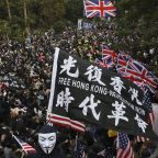 Hong Kong police fire tear gas as thousands rally