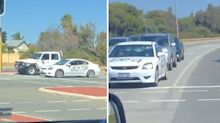Car covered in abusive messages spotted driving on Aussie road