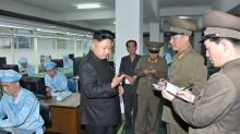 Here are some photos of Kim Jong-un inspecting the first North Korean smartphone