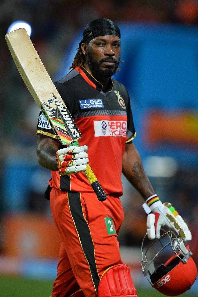 Royal Challengers Bangalore batsman Chris Gayle gestures to the cheering crowd as he walks back to the pavilion after being dismissed during a Twenty20 match in Bangalore, in May 2016 (AFP Photo/Manjunath Kiran)