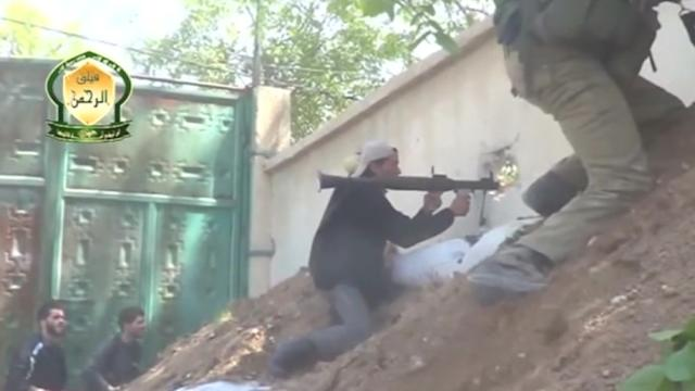 Amateur video appears to show body of government soldier outside Damascus
