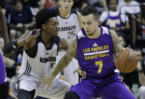 De'Aaron Fox guards the Lakers' Gabe York during an NBA summer league game Monday in Las Vegas. (AP)