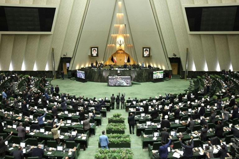 At least 31 members of Iran's parliament, seen here in session in January, have contracted the coronavirus (AFP Photo/-)