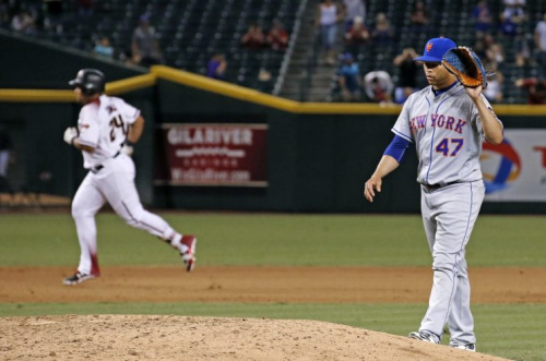 Hansel Robles did not have a good night Monday. (AP Photo)