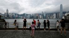 Hong Kong lowers alert as Typhoon Roke weakens