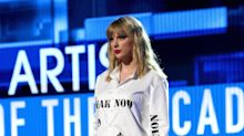 Taylor Swift Appears To Take Aim At Scooter Braun And Her Old Label At The AMAs And It's Very Taylor Swift