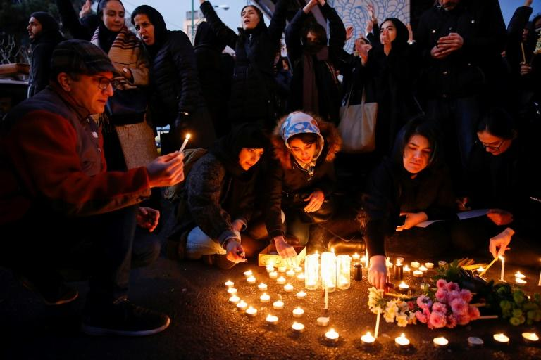 Iranians light candles for the victims of Ukraine International Airlines Boeing 737 during a gathering in front of the Amirkabir University in the capital Tehran on Saturday