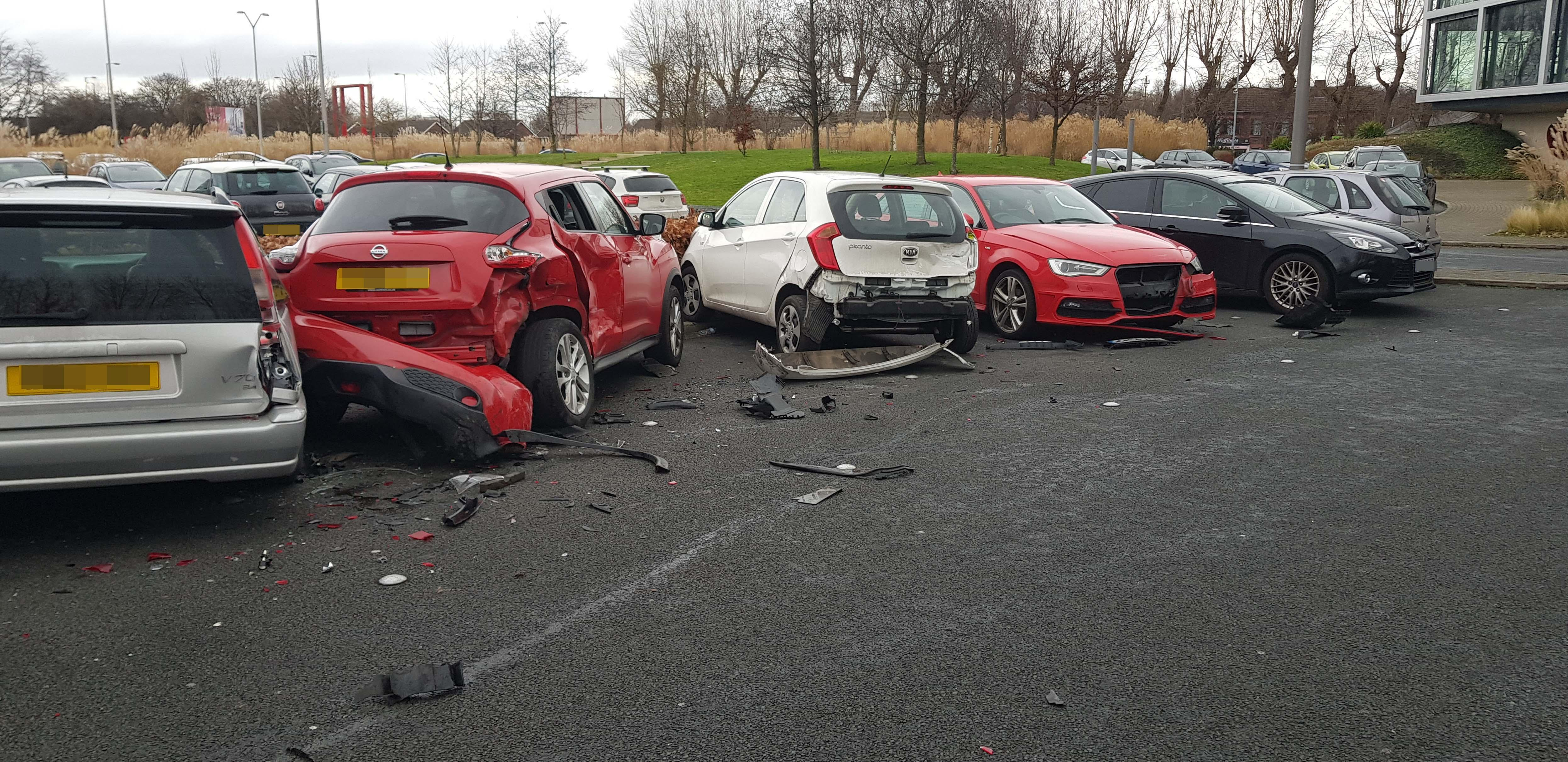 Range Rover driver ploughs into four parked cars after losing control while leaving the gym