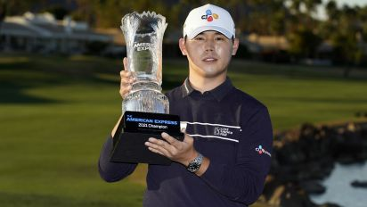 Si Woo Kim holds on for American Express title
