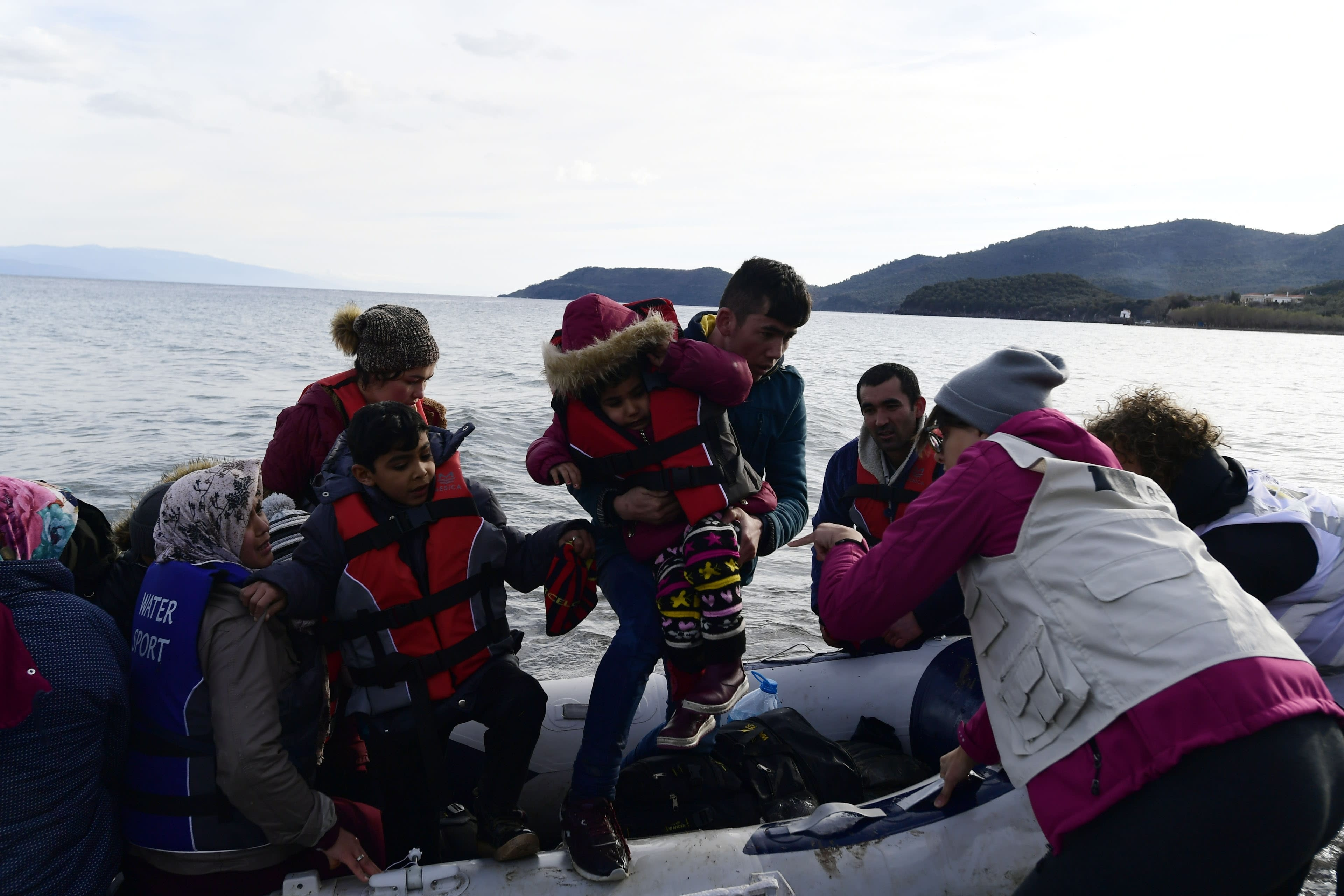 Refugees and migrants arrive with a dinghy at the village of Skala Sikaminias, on the Greek island of Lesbos, after crossing the Aegean sea from Turkey, on Friday, Feb. 28, 2020. An air strike by Syrian government forces killed scores of Turkish soldiers in northeast Syria, a Turkish official said Friday, marking the largest death toll for Turkey in a single day since it first intervened in Syria in 2016. (AP Photo/Micheal Varaklas)
