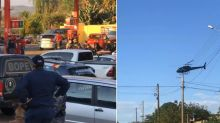 Brazil violence: Huge manhunt after family of four killed
