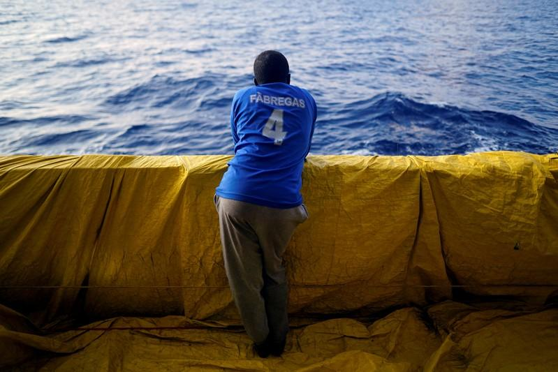 FILE PHOTO: A young Sudanese man stands on board an NGO rescue boat in central Mediterranean Sea