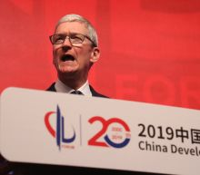 Apple's Tim Cook urges China to continue to open up its economy