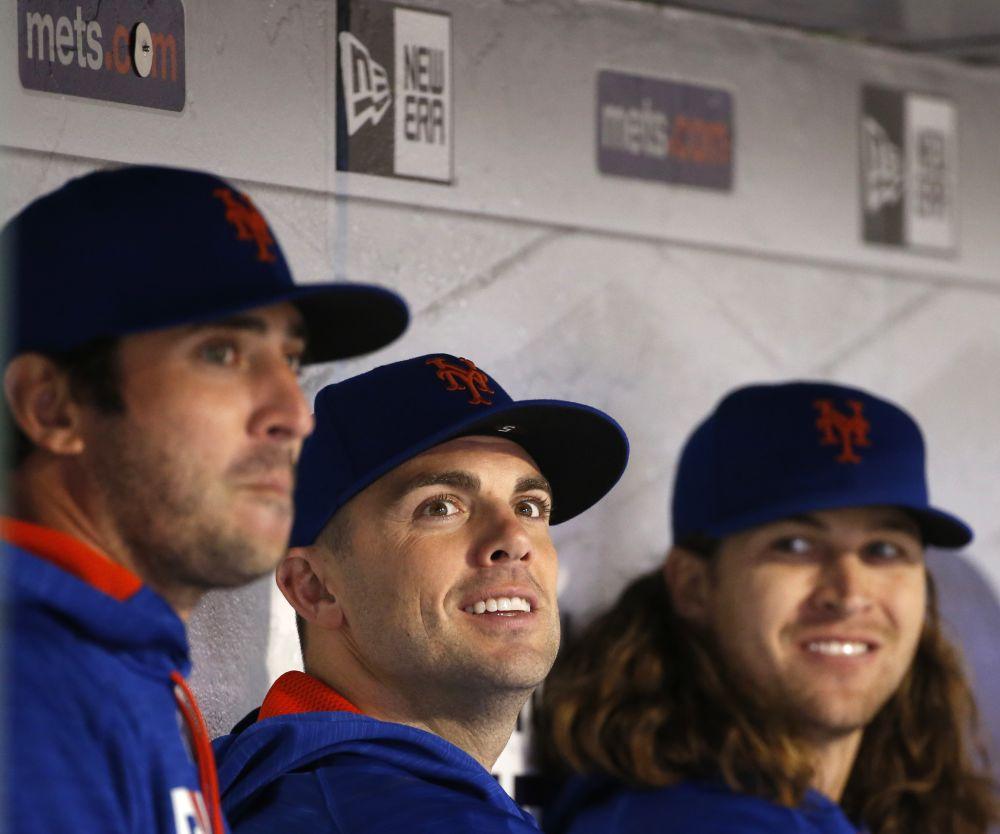 Matt Harvey, left, and David Wright, center, on the Mets bench. (AP)