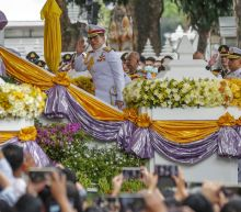 Thai king hands out diplomas at protest movement stronghold