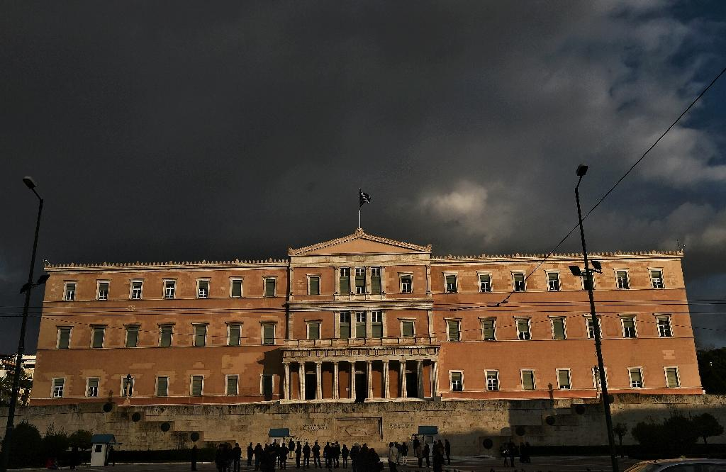 Greece's budget, to be voted on by parliament on December 10, includes extra taxation on cars, cellphones, pay TV, fuel, tobacco, coffee and beer (AFP Photo/Aris Messinis)