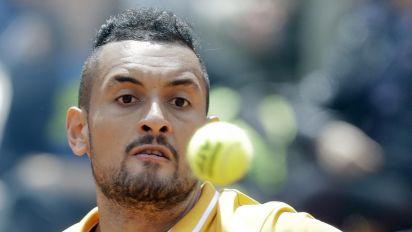 Furious Kyrgios wins in Queen's opener