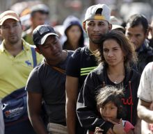 More caravan migrants arrive in Tijuana, brace for long stay