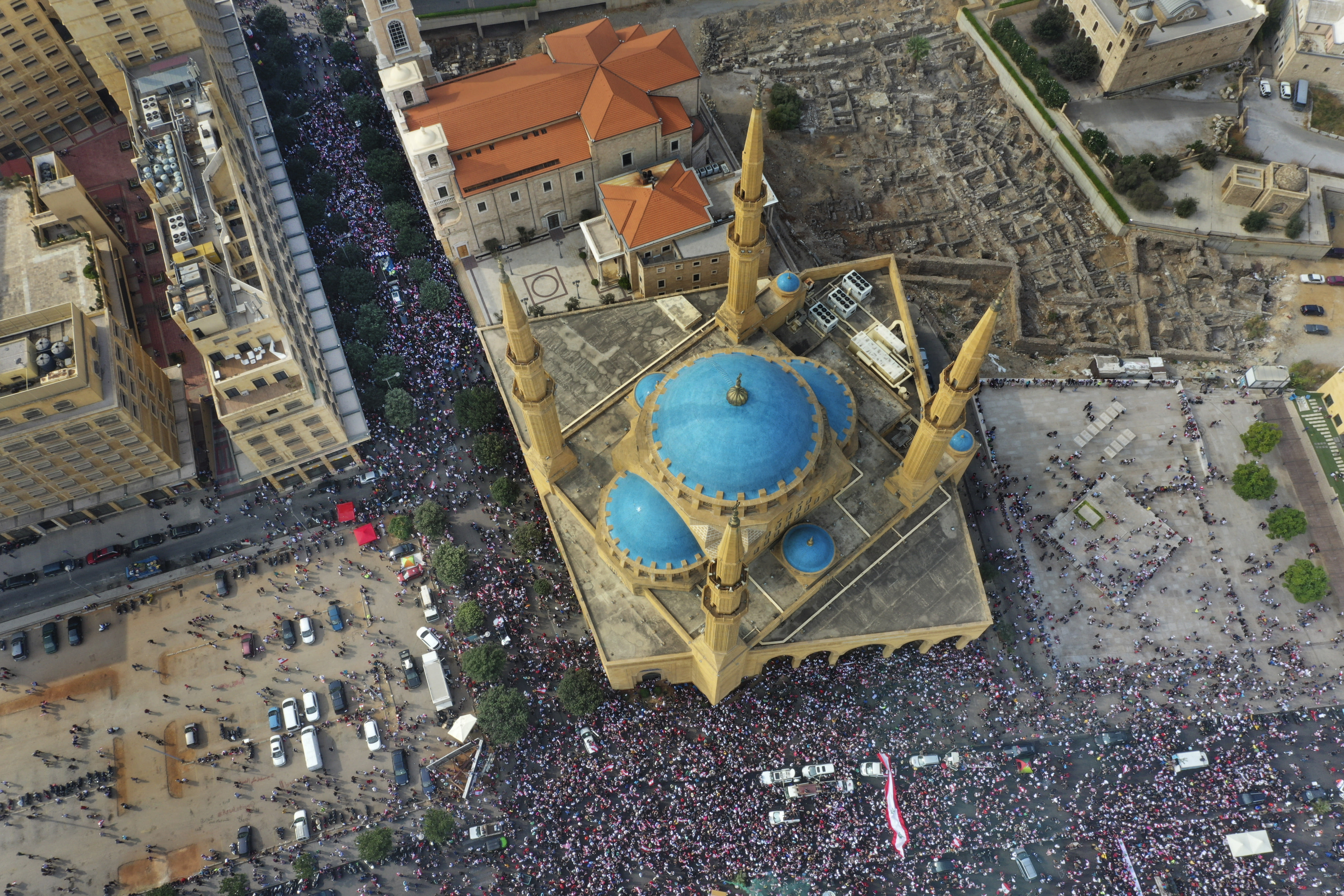 FILE - In this Sunday, Oct. 20, 2019 file photo, an aerial view shows anti-government protest, in downtown Beirut, Lebanon. A year ago, hundreds of thousands of Lebanese took to the streets in protests nationwide that raised hopes among many for a change in a political elite that over that decades has run the country into the ground. (AP Photo/Hussein Malla, File)