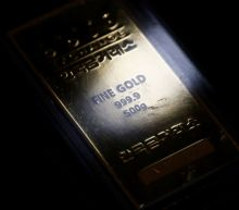 Gold gains on weaker dollar, virus woes ahead of US election