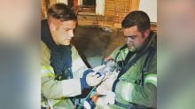 Firefighters adopt puppy after saving him from burning apartment