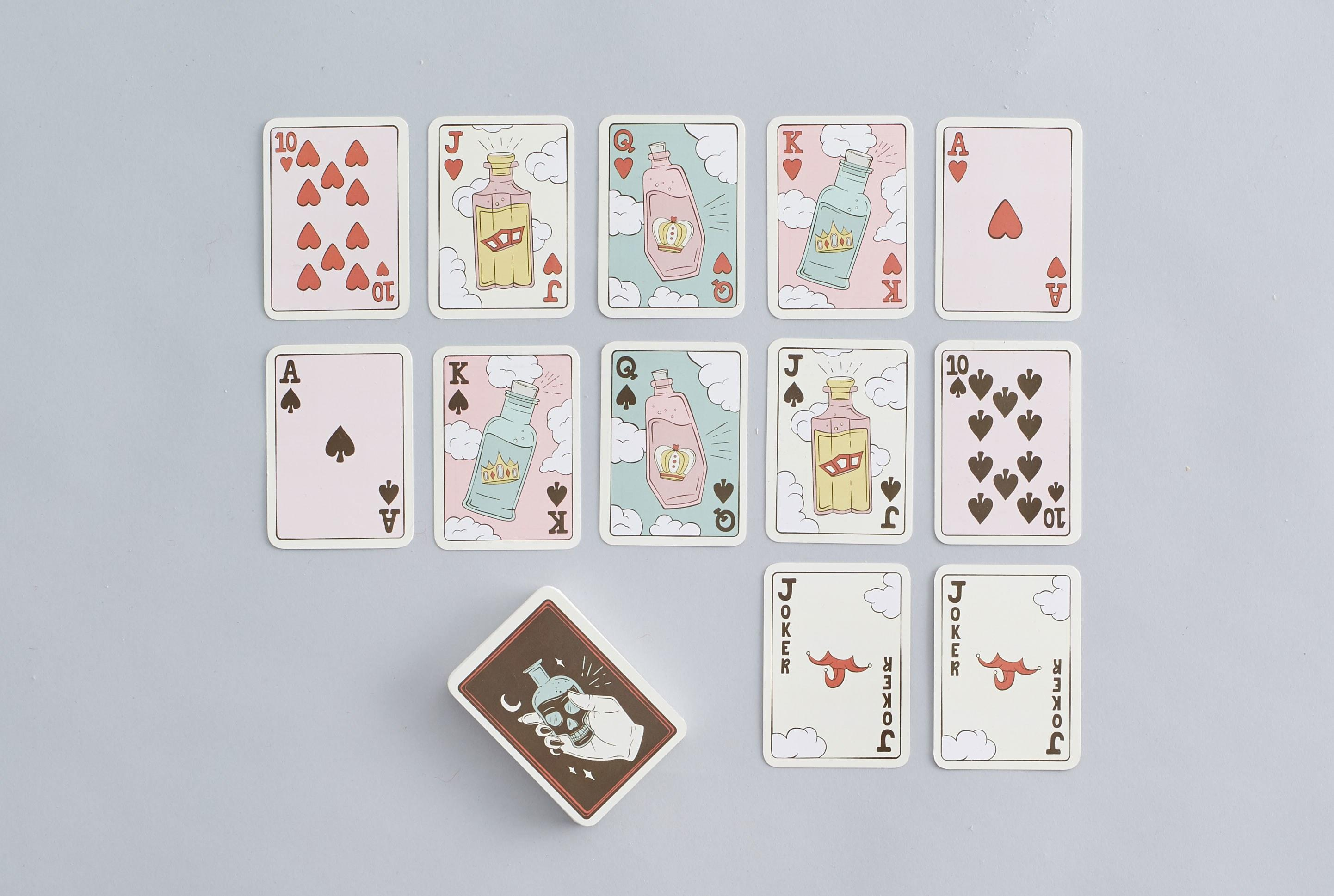 """Gin rummy—but with actually drinks on the cards, please.<br> <a href=""""https://society6.com/product/playing-cards-poison-bottle-deck"""" rel=""""nofollow noopener"""" target=""""_blank"""" data-ylk=""""slk:SHOP NOW"""" class=""""link rapid-noclick-resp"""">SHOP NOW</a>: Poison Bottle Deck by SagePizza Playing Cards, $15"""