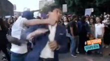 TV presenter punched live on air during protest