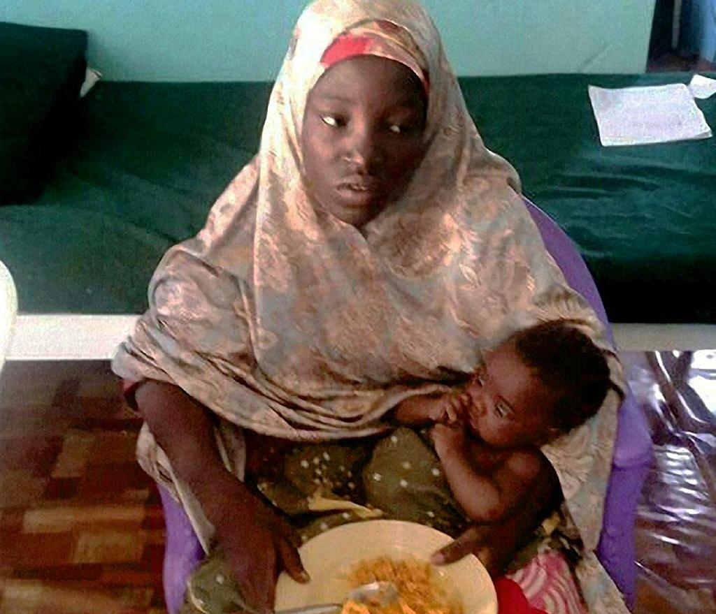 Amina Ali with her young baby was rescued by Nigerian authorities on May 18, 2016 after being one of 219 girls abducted by Boko Haram gunmen in 2014 (AFP Photo/)