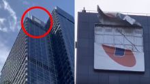 Huge sign dangles precariously from 45th floor after wild weather