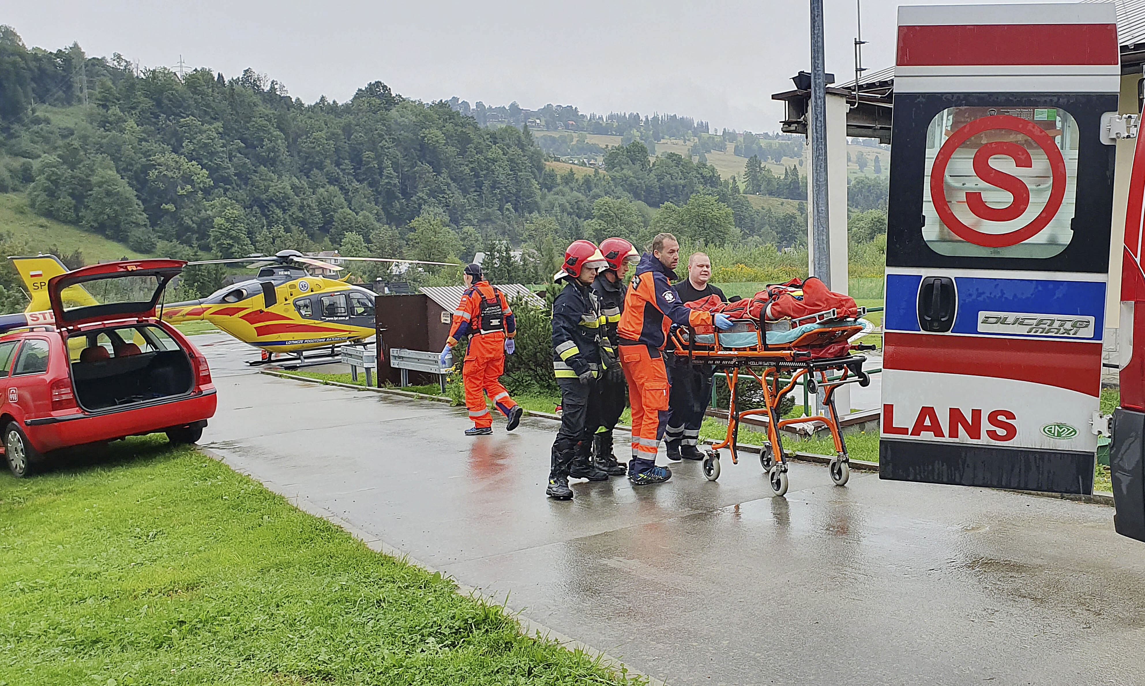 Rescue helicopter and ambulance have brought to hospital the first people injured by a lighting strike that struck in Poland's southern Tatra Mountains during a sudden thunderstorm, in Zakopane, Poland, on Thursday, Aug. 22, 2019.(AP Photo/Bartlomiej Jurecki)