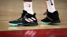 Niente strisce sulle scarpe: l'Adidas ha il monopolio