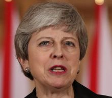 May pleads with EU for time to save her Brexit plan