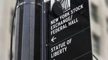 Wall cierra a la baja por problemas en plan fiscal