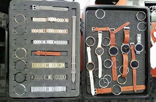 Lenovo CEO shows off briefcase full of Moto 360 smartwatches, secrets